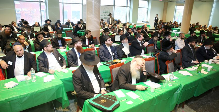 OK Kosher Orthodox Judaism Conference With Rows of Green Tables and People