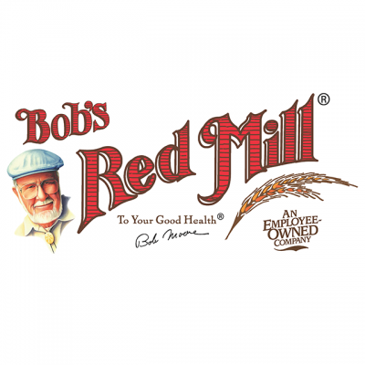 """Bob's Red Mills Natural Foods Logo: """"Bob's Red Mill - To Your Good Health, An Employee Owned Company"""" With A Drawing Of Bob And His Signature"""