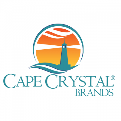 """""""Cape Crystal Brands"""" Logo With A Drawing Of A Lighthouse In Front Of An Orange Sky"""