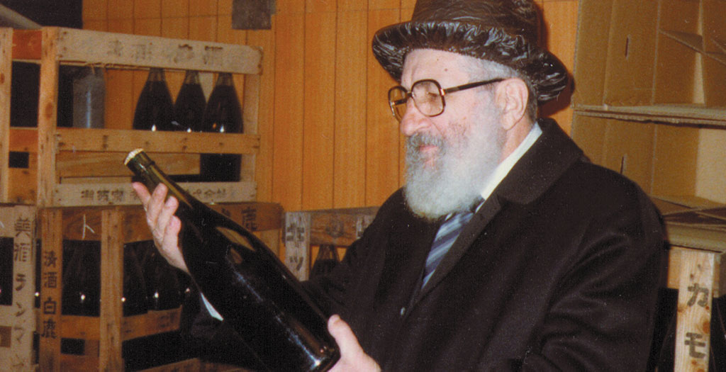 Rabbi Bernard Levy inspecting kosher wine.