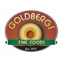 """""""Goldbergs Fine Foods: Est. 1972"""" Logo With A Bagel In The Center"""
