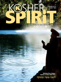 """Front Cover of """"The Kosher Spirit"""" Magazine Depicting Man Next to a River"""