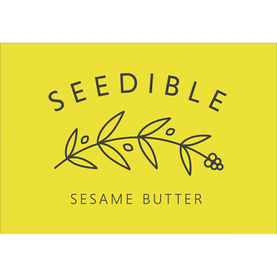 """""""Seedible: Sesame Butter"""" Logo In A Yellow Box With A Drawing Of A Branch"""